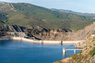 The Atazar reservoir and dam in a mountain range