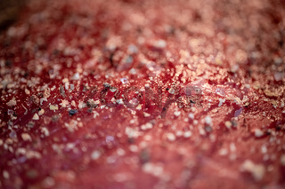 Mixed pepper and spices on the raw meat steak