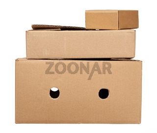 stack of closed cardboard brown paper boxes