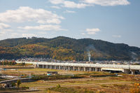 View on japanese countryside with highway bridge and forested hills on background
