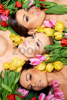 Sensual Bare Woman on Fresh Roses