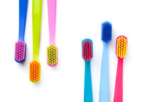 Colorful New Toothbrushes Isolated On White Background