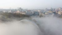 Aerial view of the city in the fog.