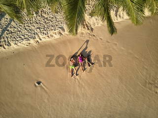 Family on beach at Seychelles aerial top view
