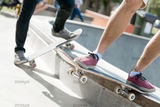 Guys riding skateboard
