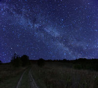 Beautiful night rural landscape with starry sky and Milky Way galaxy