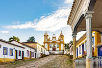 Historic church in the city of Tiradentes built in the 18th century and colonial houses around