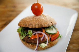 A burger isolated on a white plate with negative space
