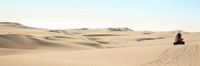 Quad driving people - one happy biker in sand desert dunes, Africa, Namibia, Namib, Walvis Bay, Swakopmund.