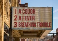 Symptoms of Coronavirus infection on downtown Main Street cinema