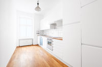 modern white kitchen or kitchenette in empty flat