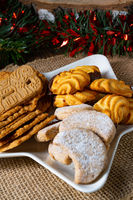 Different types of biscuits with rustic Christmas decorations