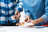 Interior designers discussing color samples
