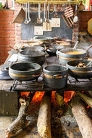 Traditional wood burning stove preparing typical Brazilian food