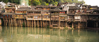 Panorama of old historic wooden Diaojiao houses in Fenghuang