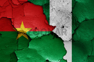 flags of Burkina Faso and Nigeria painted on cracked wall