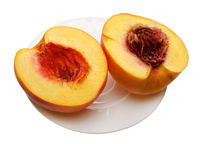 Sliced peach on the plate, isolated
