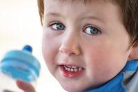 Happy Little Boy with Bottle