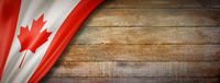 Canadian flag on vintage wood wall banner