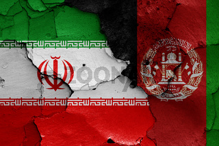flags of Iran and Afghanistan painted on cracked wall