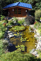 natural garden with water lily pond and garden house