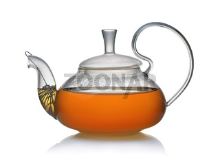 Side view of glass teapot full of fresh tea