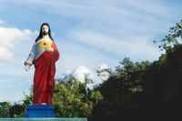 Colorful Jesus statue on the graveyard of Valladolid, Yucatan, Mexico