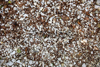 Background image of a stone crumb with small and large stones