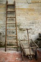 old wooden ladder and wooden wagon