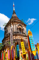 Ancient pagoda with the zodiac flags at Wat Lok Molee .