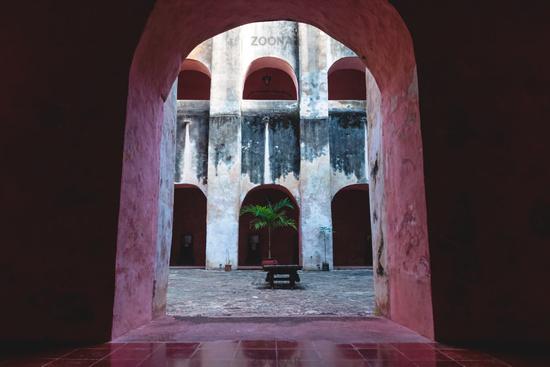 View through arch into patio in the monestary Convent de San Bernardino de Siena, Valladolid Mexico