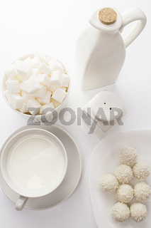 coconut milk candy sugar pieces, white food on white, top view still life. white dishes and food on a white background, high key