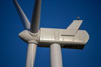 Top of a wind turbines close up across Nebraska farm lands