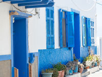 Front sides of small houses and their small streets on the volcanic island of Nisyros on the Aegean