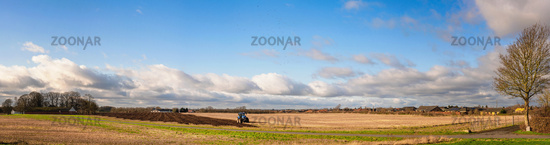 Tractor in a rural panorama landscape