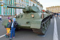 The children photographed on the background of Soviet heavy tank