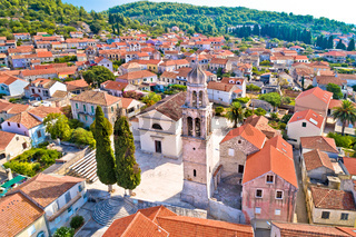 Korcula island. Town of Vela Luka church tower and rooftops aerial view