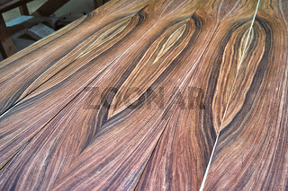 Veneer Santos Rosewood. Wood texture. Woodworking and carpentry production.