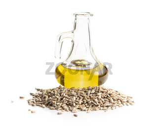 Peeled sunflower seeds and oil