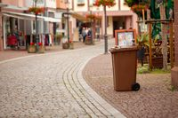 A garbage container stands on the street of a European German city