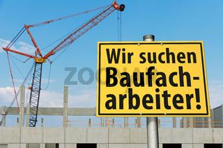 Schild: Wir suchen Baufacharbeiter!