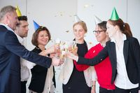 Business people at party with champagne