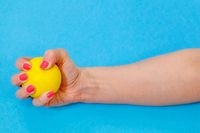 Woman squeezing yellow stress ball