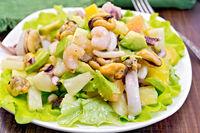 Salad seafood and avocado on board