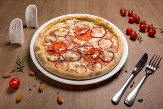 Pizza with feta and salami thin cake, cream, Italian salami, tomatoes, marinated