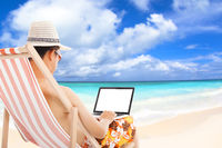 relaxed man sitting on beach chairs and using a la