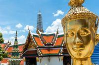 Golden Kinnari statue at Temple of Emerald Buddha (Wat Phra Kaew) in Grand Royal Palace. Half-bird, half-woman creature at south-east Asian Buddhist mythology. Bangkok