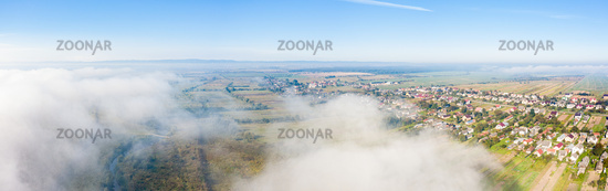 Aerial drone view of scenic countryside in autumn sunny and misty day