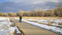 cyclist on a bike trail in winter scenery