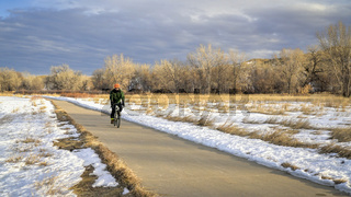 cyclist on a bike trail in winter scenery
